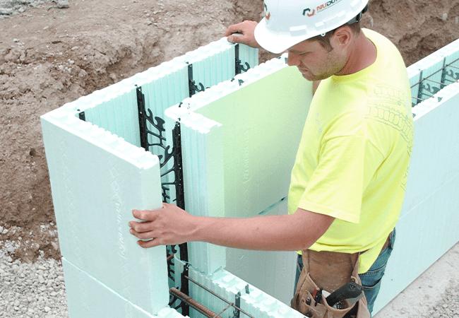 Worker installing ICF