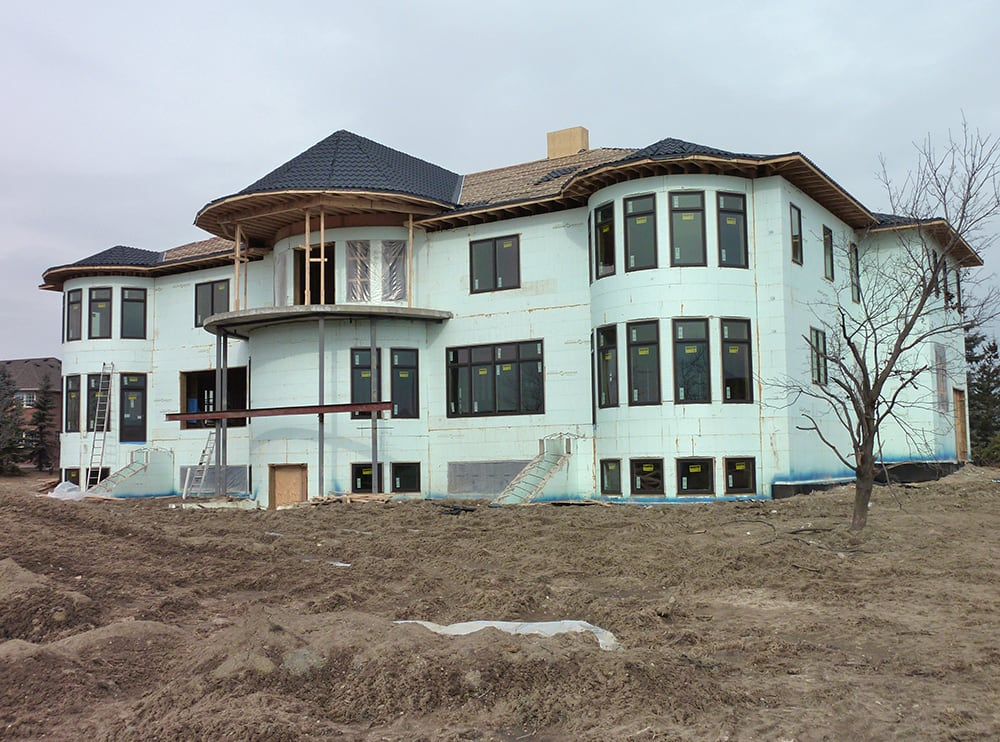 large home being built with icf